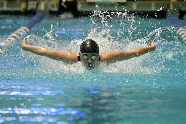 Ashley Calderon of Norwalk/McMahon swims the butterfly leg of the 200 yd medley relay during the CIAC Open Swimming Championships on Saturday November 17, 2018, at Yale University in New Haven, Connecticut.