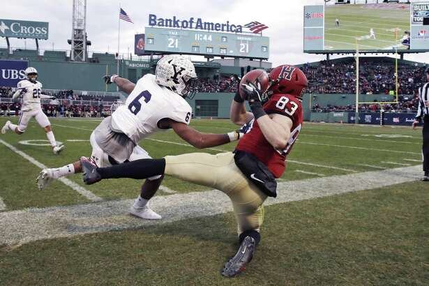 Harvard wide receiver Jack Cook, right, is forced out-of-bounds by Yale's Jaelin Alburg for an incomplete on Saturday.
