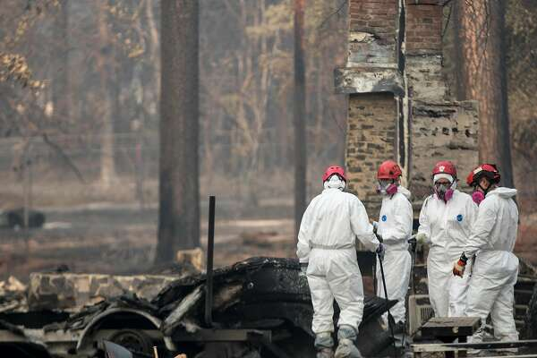 Search and Rescue crews sift through the rubble of homes for human remains in Paradise, Calif. Saturday, Nov. 17, 2018 after the Camp Fire ripped through the entire town.