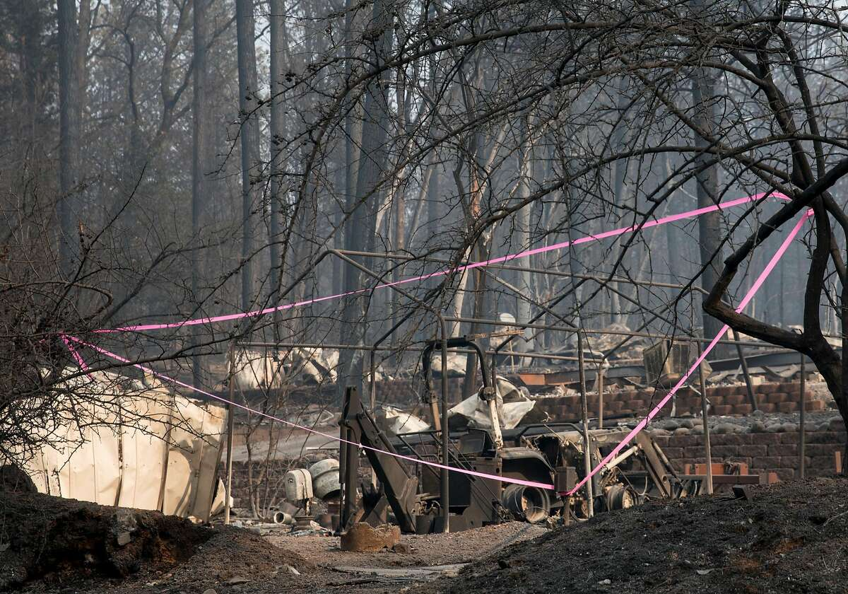 Caution tape surrounds an area where human remains were found inside a charred home in Holly Hills Mobile Estates in Paradise, Calif. Saturday, Nov. 17, 2018 after the Camp Fire ripped through the town, destroying most structures.