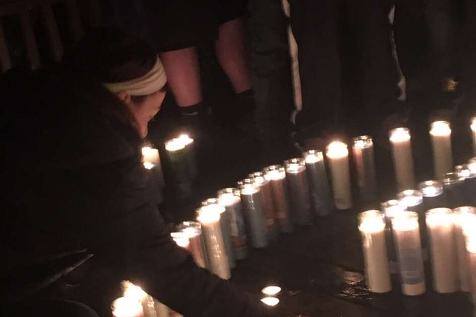 Cohoes youths light candles for the teen killed near the Cohoes bike trail Friday night.