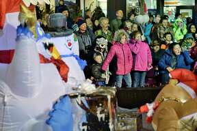 An enthusiastic crowd watches the 50th anniversary Holiday Parade through downtown Saturday Nov. 17, 2018 in Schenectady, NY. (John Carl D'Annibale/Times Union)