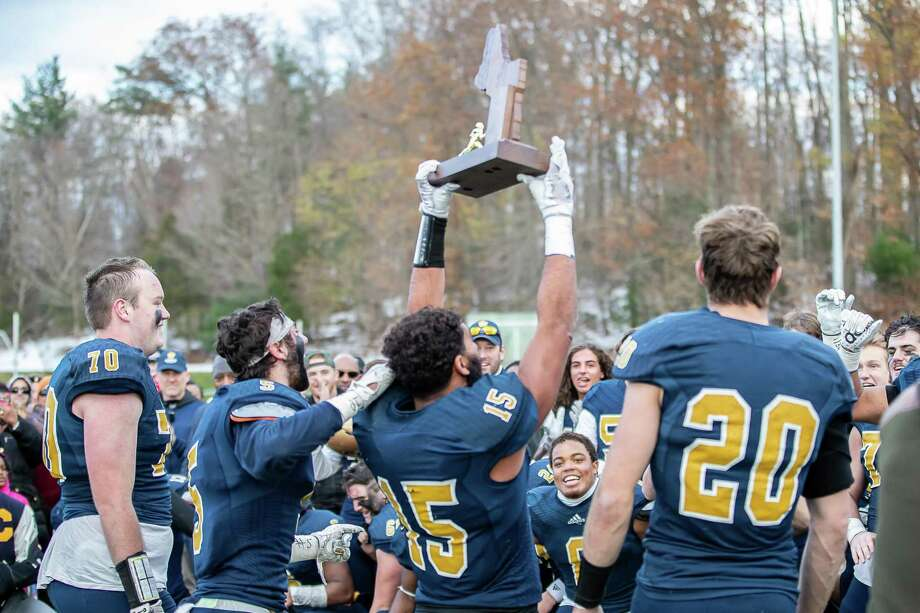 Choate Captains Clay Zachery (15), Spencer Witter (20), Hunter Burns (5) and James McCarthy (70) share the Championship Trophy with their team during the Mike Silipo Bowl between Choate and Brunswick on November 17, 2018 at Choate Rosemary Hall in Wallingford, CT. Photo: John McCreary / For Hearst Connecticut Media / Connecticut Post Freelance