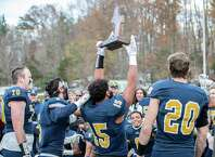 Choate Captains Clay Zachery (15), Spencer Witter (20), Hunter Burns (5) and James McCarthy (70) share the Championship Trophy with their team during the Mike Silipo Bowl between Choate and Brunswick on November 17, 2018 at Choate Rosemary Hall in Wallingford, CT.