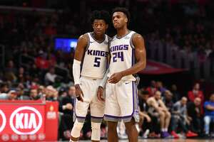 LOS ANGELES, CA - JANUARY 13: Sacramento Kings Guard De'Aaron Fox (5) and Sacramento Kings Guard Buddy Hield (24) look on during an NBA game between the Sacramento Kings and the Los Angeles Clippers on January 06, 2018 at STAPLES Center in Los Angeles, CA. (Photo by Brian Rothmuller/Icon Sportswire via Getty Images)