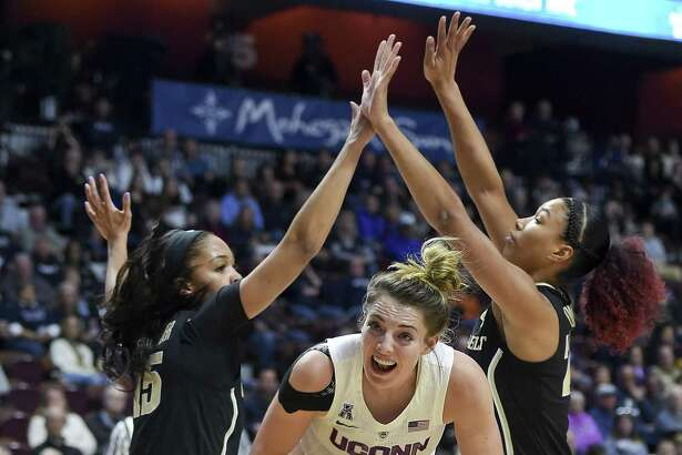 UConn's Katie Lou Samuelson (33) slices between Vanderbilt's Brinae Alexander (15) and Autumn Newby during the first half of Saturday's game in Uncasville.