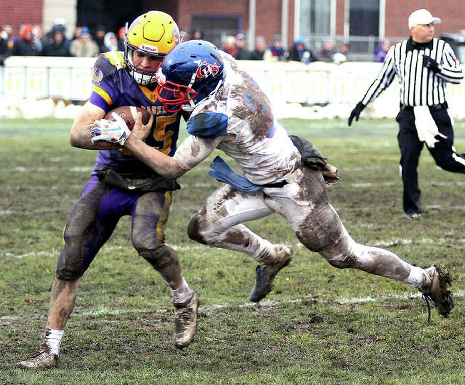Carlinville safety Kyle Dixon (right) takes down Monticello running back Alek Bundy during Saturday's Class 3A football semifinal at Monticello. Bundy rushed for 110 yards on the Sages' 40-14 victory. Photo: Greg Shashack | The Telegraph