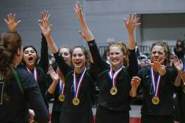Kingwood Park junior Elizabeth Overmyer (4) is congratulated by her teammates after being named MVP in the a Class 5A State Championship volleyball game at the Curtis Culwell Center in Garland, Texas, Saturday, November 17, 2018. Kingwood Park won three straight sets to win the state championship. Special to the Houston Chronicle/Brandon Wade.