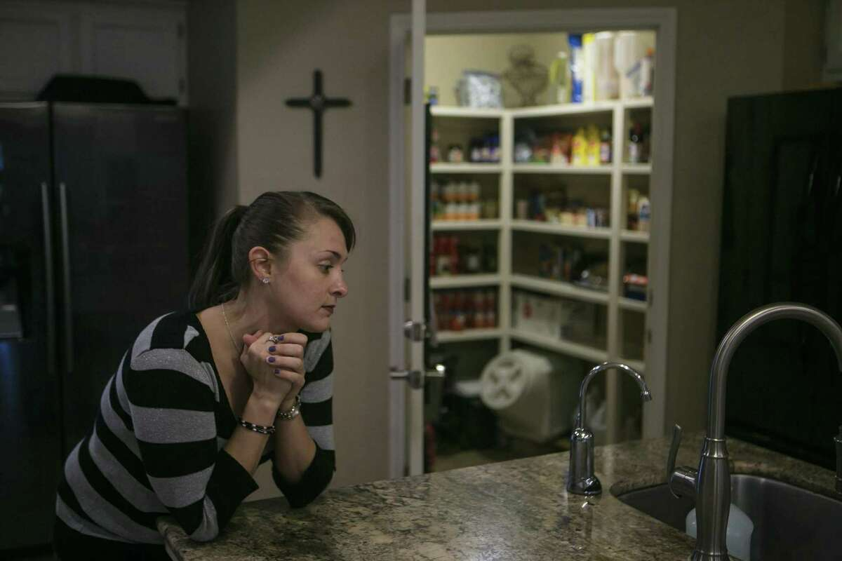 Heath Kokoshak watches her roomate and fellow lunch preparer Kirstie Elrod (not pictured) cook at Grace House of San Antonio, Friday, Nov. 9, 2018. Grace House of San Antonio is a faith-based residential home for women who have been incarcerated, struggling with addiction and provides a structured environment with classes for recovery from addiction, career skills and scripture, along with daily devotionals and shared responsibilities throughout the house.
