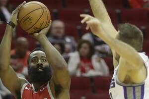 Houston Rockets James Harden shoots past Sacramento Kings Nemanja Bjelica during the first half of game at Toyota Center Saturday, Nov. 17, 2018, in Houston.