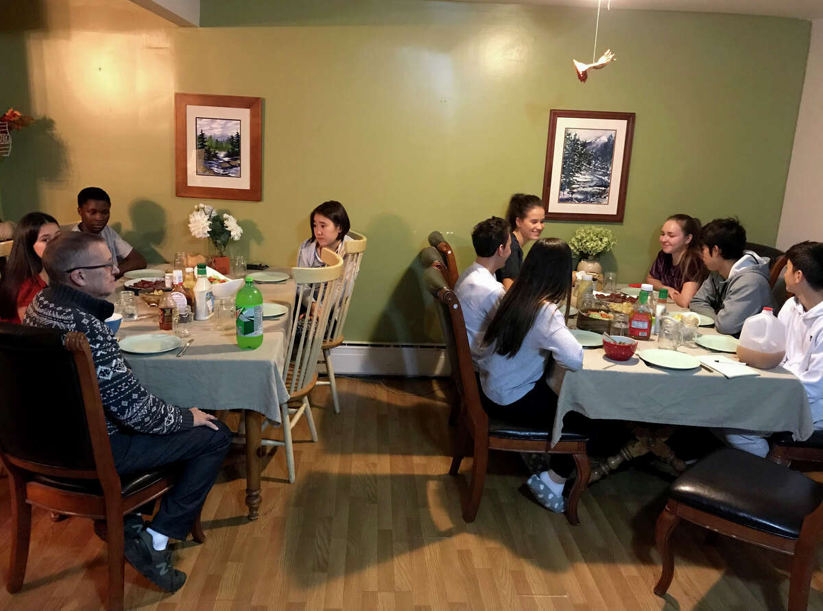 Foreign exchange students from Spain, Russian, Japan and Zimbabwe gather for dinner each night with the Hults family which is hosting them in a large rented home on Monday Nov. 12, 2018, in Newcomb, N.Y. International students have been coming to the Newcomb school for more than a decade. (Rick Karlin/Times Union)