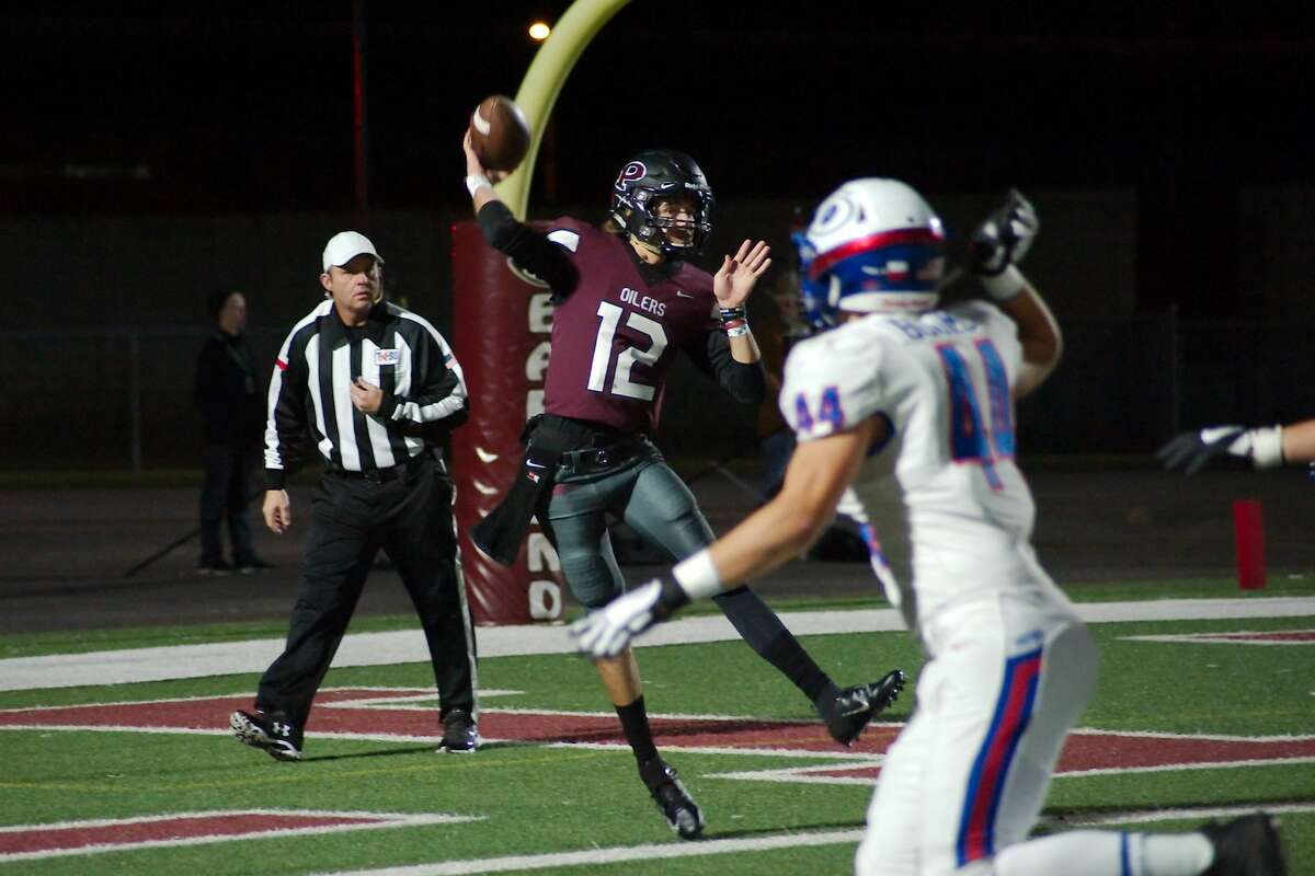 Pearland's Jd Head (12) drops back to pass against Dickinson Friday, Nov. 16 at Pearland High School.