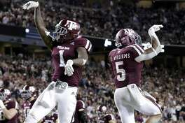 Texas A&M wide receiver Quartney Davis (1) and running back Trayveon Williams (5) celebrate Williams' touchdown during the first half of an NCAA college football game against UAB on Saturday, Nov. 17, 2018, in College Station, Texas. (AP Photo/Michael Wyke)