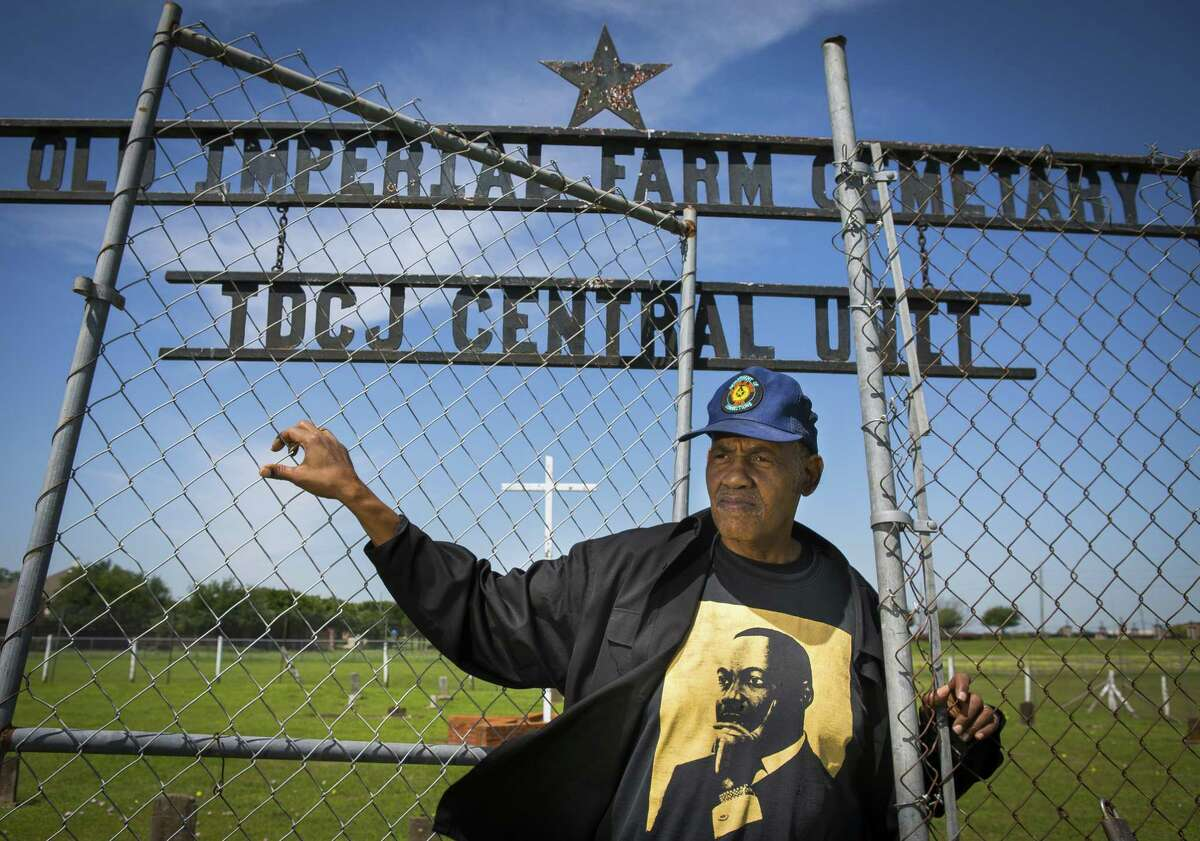 This photo taken April 10, 2018, shows Reginald Moore, who has been striving for years to get recognition for the Old Imperial Farm cemetery that houses some bodies believed to be a part of the convict leasing system in Sugar Land, standing inside the cemetery where he serves as the steward, in Sugar Land, Texas. City officials in the Houston suburb are calling for a cemetery reburial of the remains found in dozens of unmarked graves at a school district?'s construction site. The Houston Chronicle reports that Sugar Land City Council recommended Tuesday, Oct. 23, 2018, that the remains discovered at the Fort Bend district site in April be buried at the city?'s Old Imperial Farm Cemetery. (Mark Mulligan/Houston Chronicle via AP)
