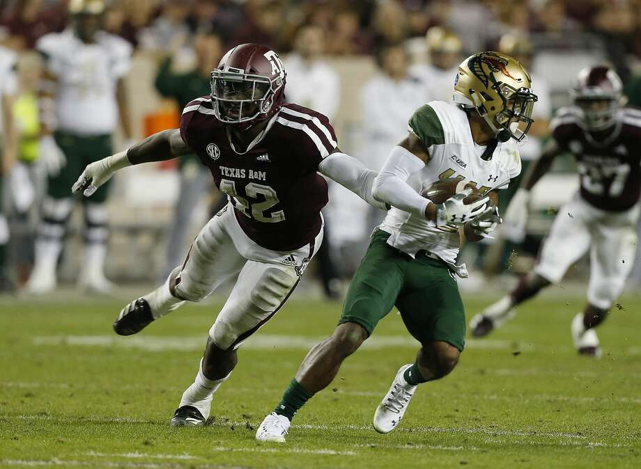 PHOTOS:New Era's official 2019 NFL Draft caps COLLEGE STATION, TEXAS - NOVEMBER 17: Andre Wilson #3 of the UAB Blazers avoids the tackle attempt by Otaro Alaka #42 of the Texas A&M Aggies in the second quarter at Kyle Field on November 17, 2018 in College Station, Texas. (Photo by Bob Levey/Getty Images) >>>A look at the caps that will be worn by players at the 2019 NFL Draft ... Photo: Bob Levey/Getty Images