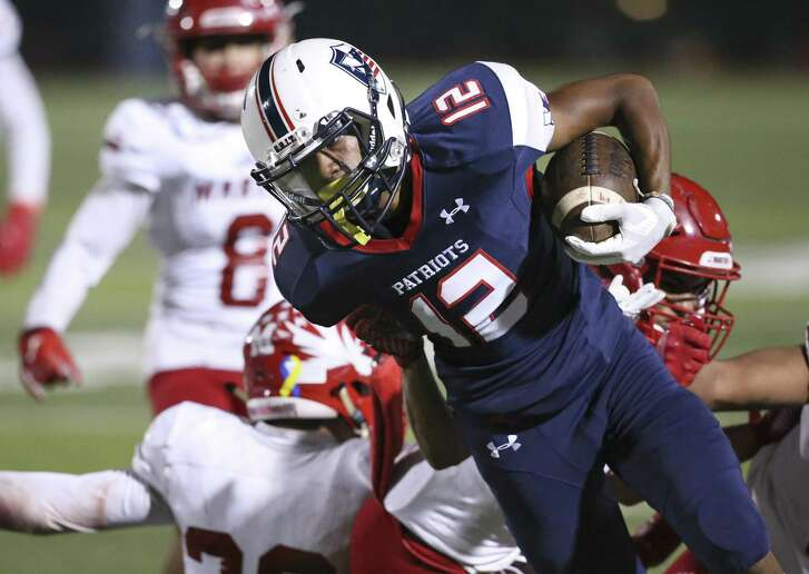 Patriot receiver Darius Guess rolls for extra yards after a catch in the first half as Veterans Memorial hosts Laredo Martin in first round playoff action at Rutledge Stadium on November 17, 2018.