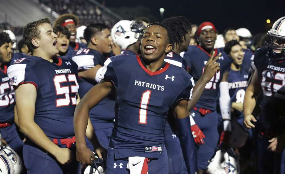 Patriot quarterback Joseph Richardson joins the celebration before home fans as Veterans Memorial beats Laredo Martin in first round playoff action at Rutledge Stadium on November 17, 2018. Photo: Tom Reel, Staff / Staff Photographer / 2017 SAN ANTONIO EXPRESS-NEWS