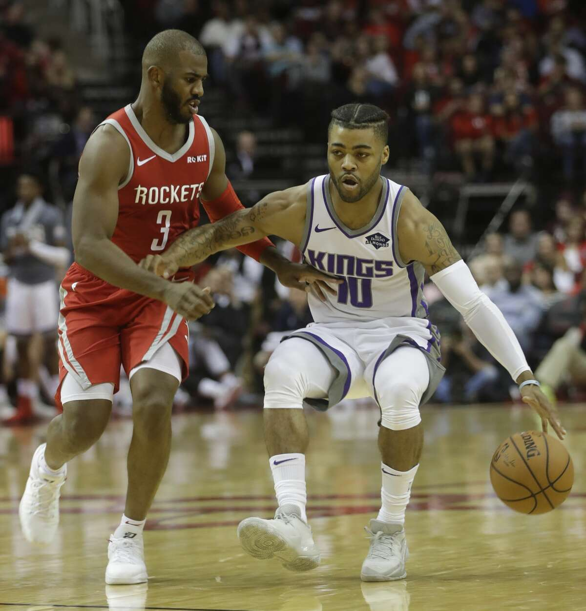 Houston Rockets Chris Paul guards Sacramento Kings Frank Mason III during the second half of game at Toyota Center Saturday, Nov. 17, 2018, in Houston.