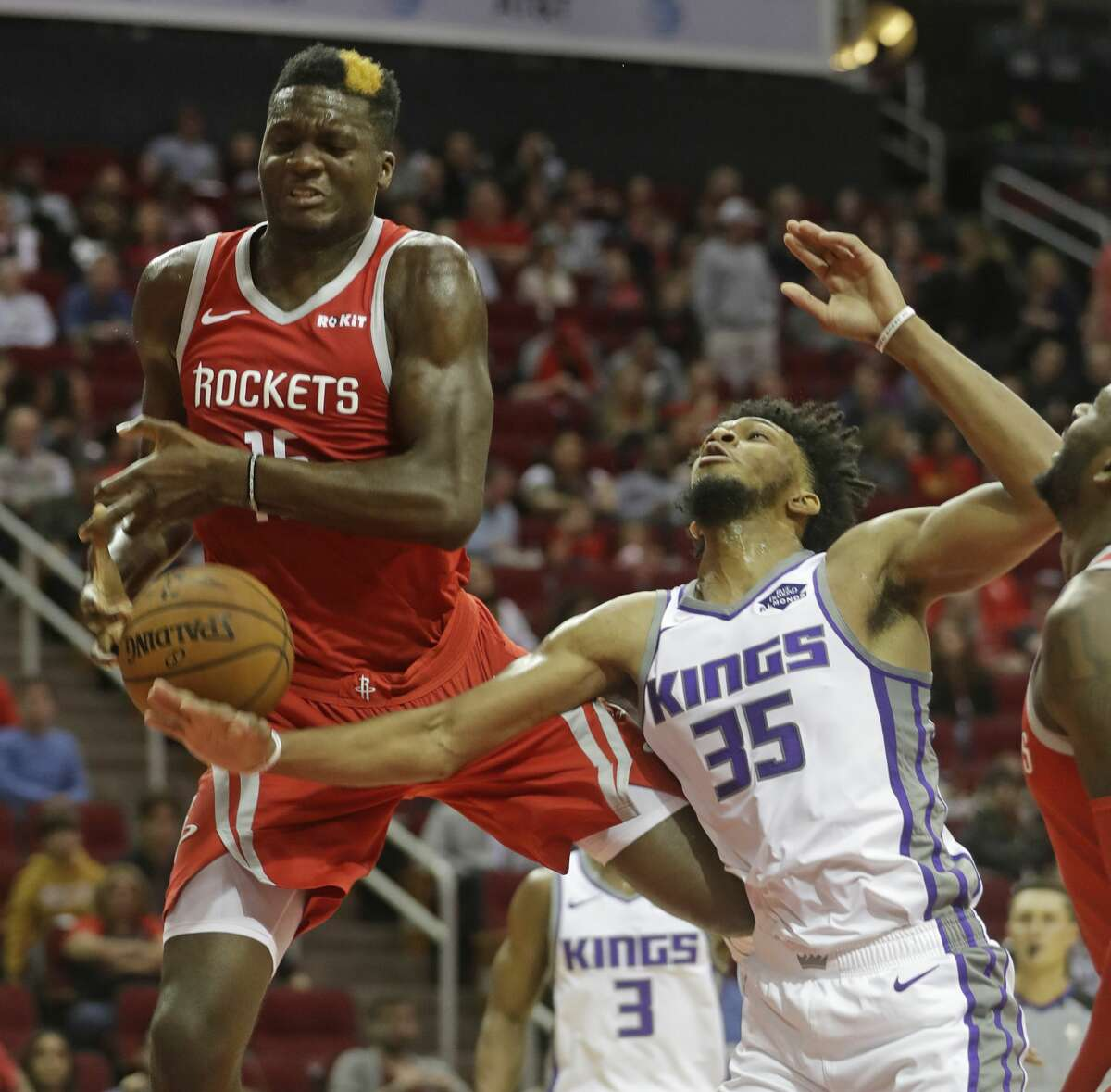 Houston Rockets Clint Capela and Sacramento Kings Marvin Bagley III tangle for a rebound during the first half of game at Toyota Center Saturday, Nov. 17, 2018, in Houston.
