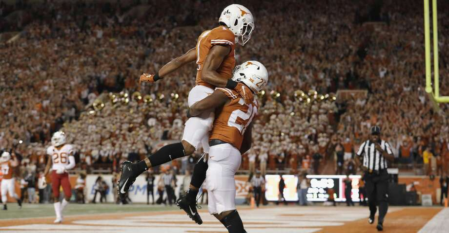AUSTIN, TX - NOVEMBER 17:  John Burt #1 of the Texas Longhorns celebrates with Keaontay Ingram #26 after a second quarter touchdown against the Iowa State Cyclones at Darrell K Royal-Texas Memorial Stadium on November 17, 2018 in Austin, Texas.  (Photo by Tim Warner/Getty Images) Photo: Tim Warner/Getty Images