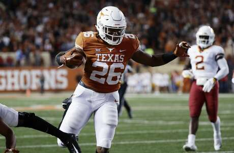 Texas running back Keaontay Ingram (26) scores a touchdown on a 19-yard pass against Iowa State during the first half of an NCAA college football game, Saturday, Nov. 17, 2018, in Austin, Texas. (AP Photo/Eric Gay)
