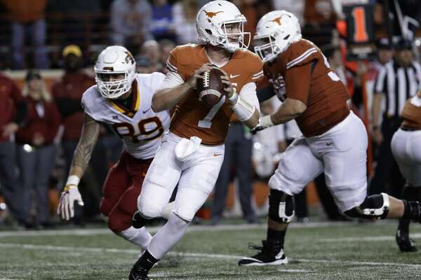 Texas quarterback Shane Buechele (7) looks to throw against Iowa State during the second half of an NCAA college football game, Saturday, Nov. 17, 2018, in Austin, Texas. (AP Photo/Eric Gay)