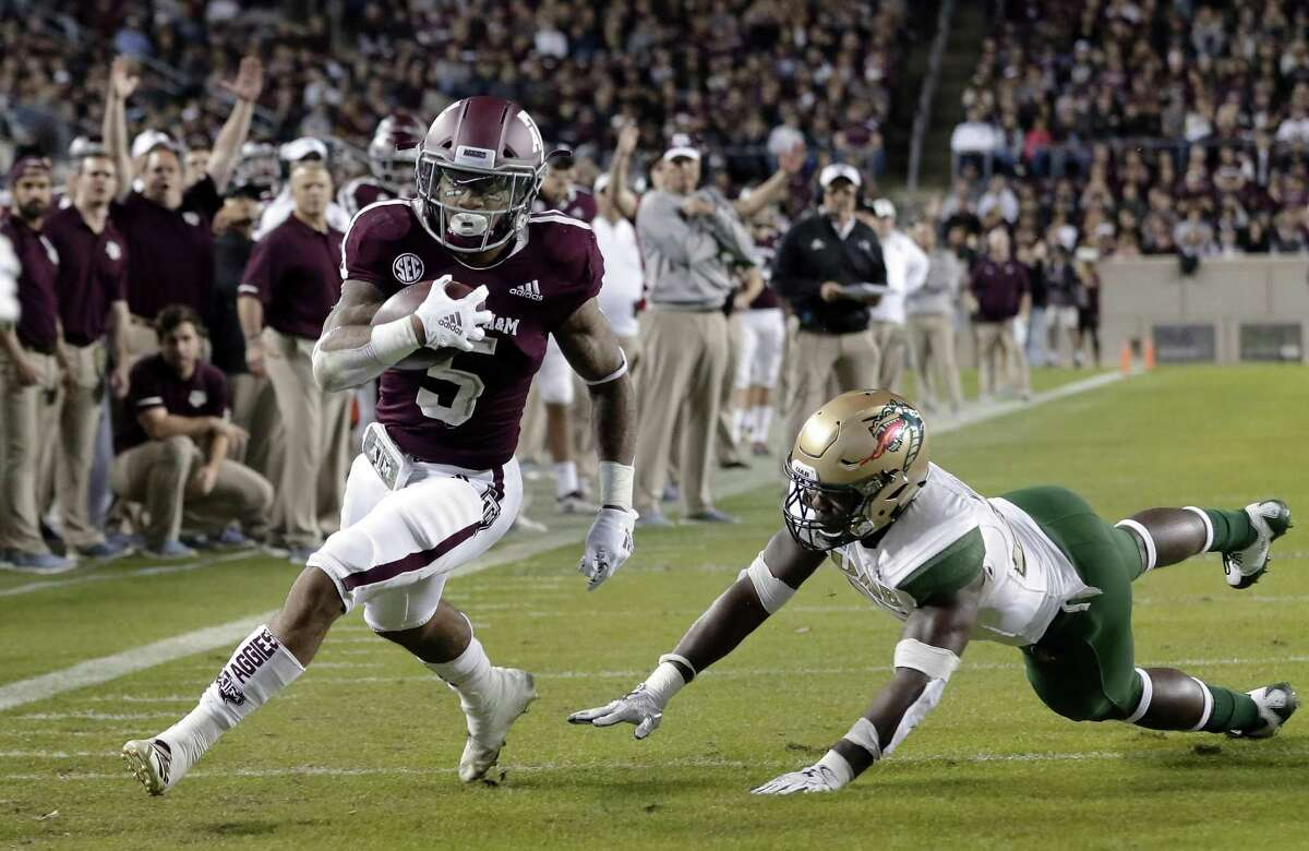 PHOTOS: Former Texas HS quarterbacks who have started in NFL playoffs Texas A&M running back Trayveon Williams (5) dodges the tackle attempt by UAB linebacker Chris Woolbright, right, to score during the first half of an NCAA college football game Saturday, Nov. 17, 2018, in College Station, Texas. (AP Photo/Michael Wyke) >>>Browse through the photos for a look at former Texas HS QBs who have started in the NFL playoffs ...