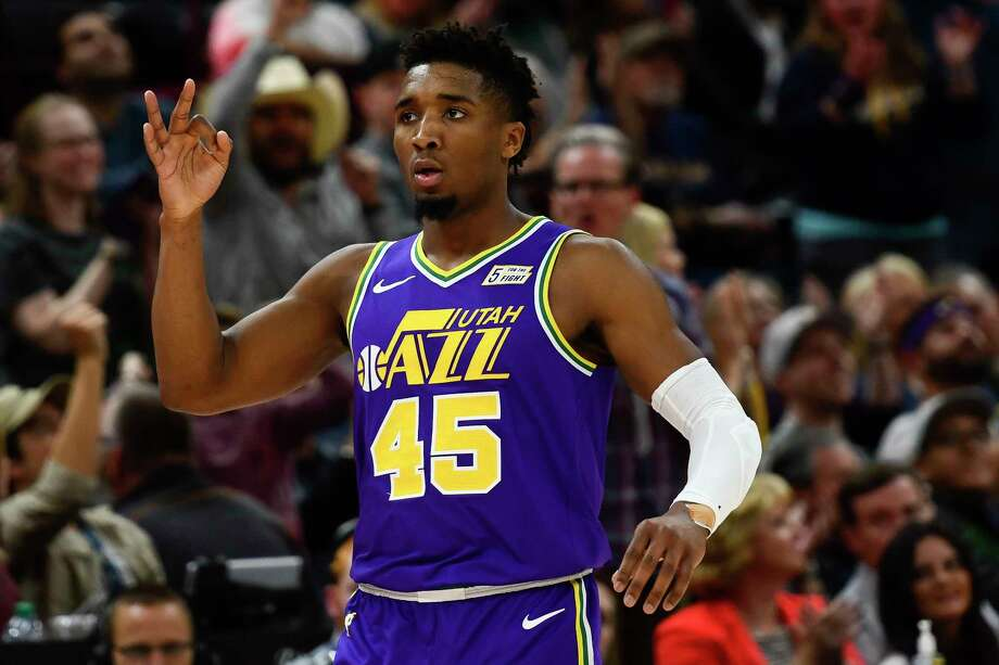 17ad41497 Utah Jazz guard Donovan Mitchell celebrates a 3-point basket during the  second half of