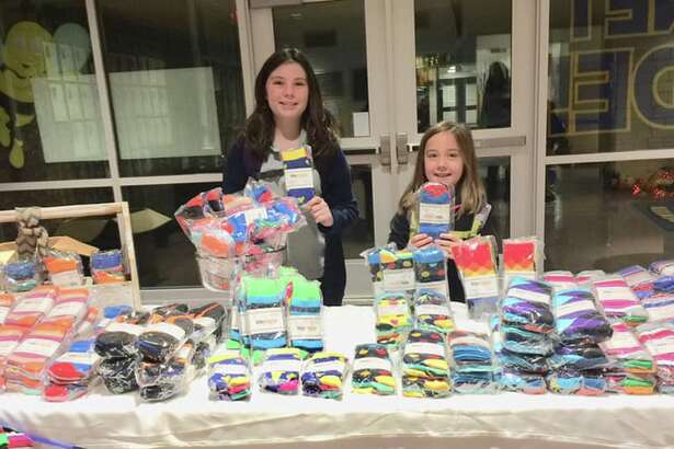 Lorelei Parrish, left, and Finley Parrish are among Carver Center students who sold socks for the school's fund-raiser.