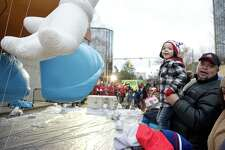 Mathew Rito, 4, and his dad, Julio, of White Plains, N.Y., look at the balloons during the Point72 Giant Balloon Inflation Party, a precursor to the Stamford Downtown Parade Spectacular, in Stamford on Saturday.