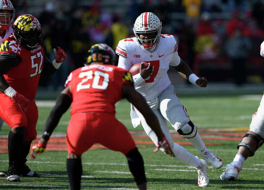 Ohio State quarterback Dwayne Haskins Jr. (7) runs with the ball against Maryland defensive back Antwaine Richardson (20) and defensive lineman Oluwaseun Oluwatimi (52) during the first half of an NCAA football game, Saturday, Nov. 17, 2018, in College Park, Md. (AP Photo/Nick Wass) Photo: Nick Wass / Copyright 2018 The Associated Press. All rights reserved.