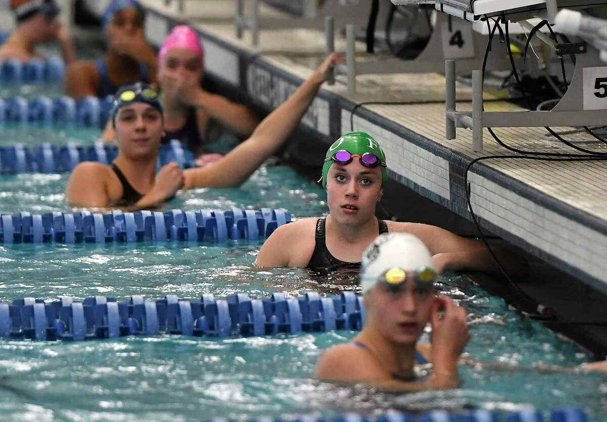 Fonda-Johnstown's Alayna Gray reacts to her time after swimming in the finals of the 50 yard freestyle during the 2018 NYSPHSAA Girls Swimming & Diving Championships in Ithaca, N.Y., Saturday, Nov. 17, 2018. (Adrian Kraus / Special to the Times Union)