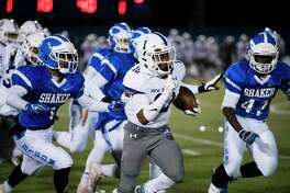 New Rochelle junior running back Omari Walker (10) runs the ball during the Class AA semifinal game at Middletown High School in Middletown, New York, on Saturday, Nov. 17, 2018. New Rochelle defeated Shaker 27-19 to advance to the state championship game. (Ben Moffat/Special to the Times Union)