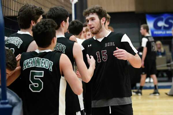 Burnt Hills-Ballston Lake's Derek Haughey (15) congratsulates Bellmore JFK players after the New York State Public High School Athletic Association boys volleyball championship game Saturday, Nov. 17, 2018 in Albany, N.Y., Bellmore JFK won the match 3 games to 1. (Hans Pennink / Special to the Times Union)