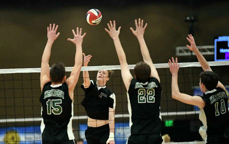 Burnt Hills-Ballston Lake's Jake Baker (7) returns the ball against Bellmore JFK in the New York State Public High School Athletic Association boys volleyball championship game Saturday, Nov. 17, 2018 in Albany, N.Y., Bellmore JFK won the match 3 games to 1. (Hans Pennink / Special to the Times Union) Photo: Hans Pennink / 20045507A