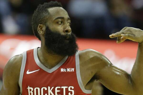 Houston Rockets James Harden signals one of his three point shots against the Sacramento Kings during the second half of game at Toyota Center Saturday, Nov. 17, 2018, in Houston.
