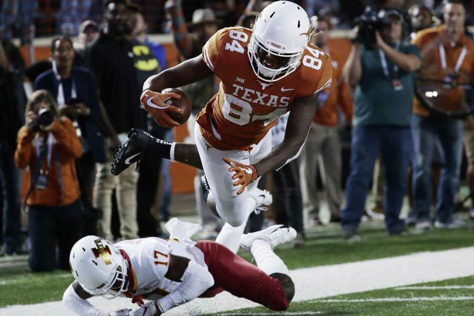 Texas wide receiver Lil'Jordan Humphrey leaps over Iowa State defensive back Richard Bowens III to score a touchdown on a 27-yard pass in the third quarter.