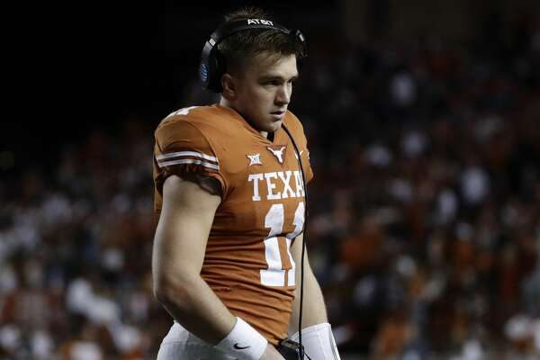 Texas starting quarterback Sam Ehlinger (11) stands on the sideline during the second half of an NCAA college football game against Iowa State, Saturday, Nov. 17, 2018, in Austin, Texas. (AP Photo/Eric Gay)