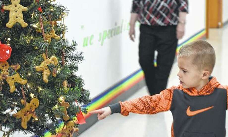 Landyn Flynn, the son of Rachel and Chad Flynn of Jacksonville, looks at the different trees at Pathway Services Saturday during the Festival of Trees. Photo: Samantha McDaniel-Ogletree | Journal-Courier