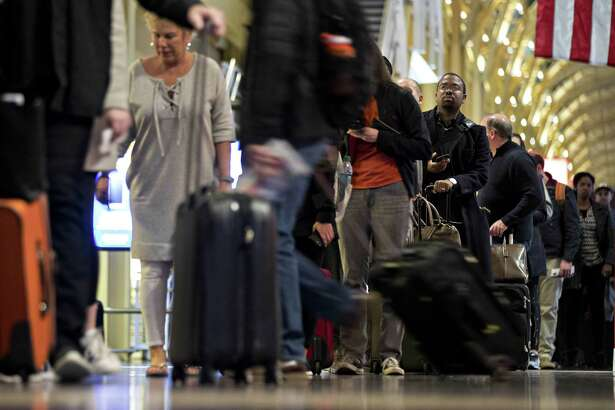 Travelers wait in line at Ronald Reagan National Airport in Washington on Nov. 22, 2017.