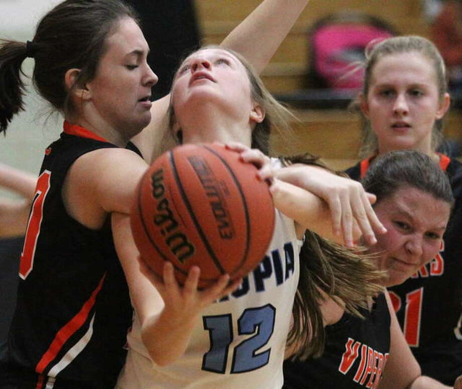 Triopia's Maddie Gregory draws contact under the basket during a girls' basketball game against South County in the Waverly Thanksgiving Tournament Saturday morning in Waverly. Photo: Dennis Mathes | Journal-Courier
