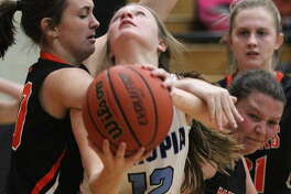 Triopia's Maddie Gregory draws contact under the basket during a girls' basketball game against South County in the Waverly Thanksgiving Tournament Saturday morning in Waverly.