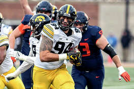 Iowa's A.J. Epenesa, a sophomore defensive end from Edwardsville High, runs the ball into the end zone after forcing and then recovering a fumble in the first half Saturday at Illinois. Epenesa, a former Telegraph Player of the Year, also blocked a punt, had five solo tackles and three assists for the Hawkeyes.