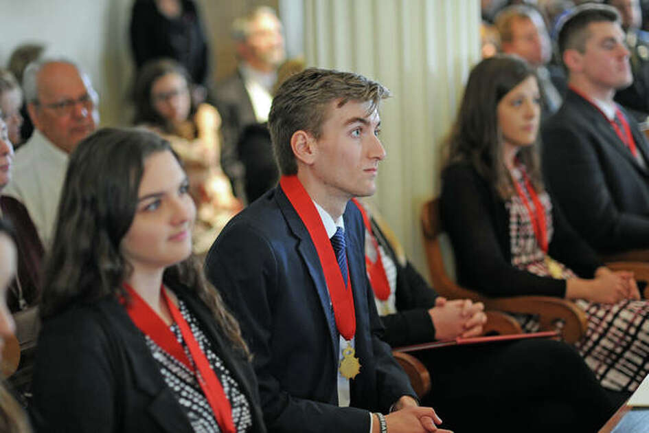 SIUE senior Austin C. Tuttle, center, listens to a speaker during Saturday's Student Laureate ceremony at the Old State Capitol in Springfield.