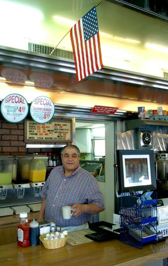 Greg Cerminara, who operates White's Diner, poses for a photo at the diner on Boston Avenue in Bridgeport, Conn. on Saturday July 17, 2010. Cerminara gives free meals to active-duty military servicemen and women, usually on the last day of each month. Photo: Christian Abraham / Connecticut Post