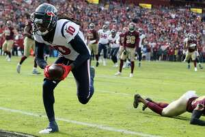 Houston Texans wide receiver DeAndre Hopkins (10) runs into the end zone for a touchdown against Washington during the first quarter of an NFL football game at FedEx Field on Sunday, Nov. 18, 2018, in Landover.