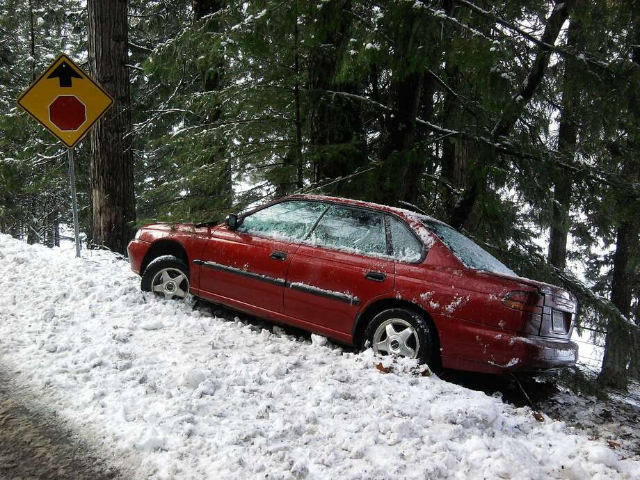 On two-lane country road in Lake Tahoe Basin, this compact car spun out, braking too hard at low speed down hill on ice as it approached stop sign -- creating too much torque for tires to hold traction -- and ended up in the snow bank Photo: Tom Stienstra / Tom Stienstra