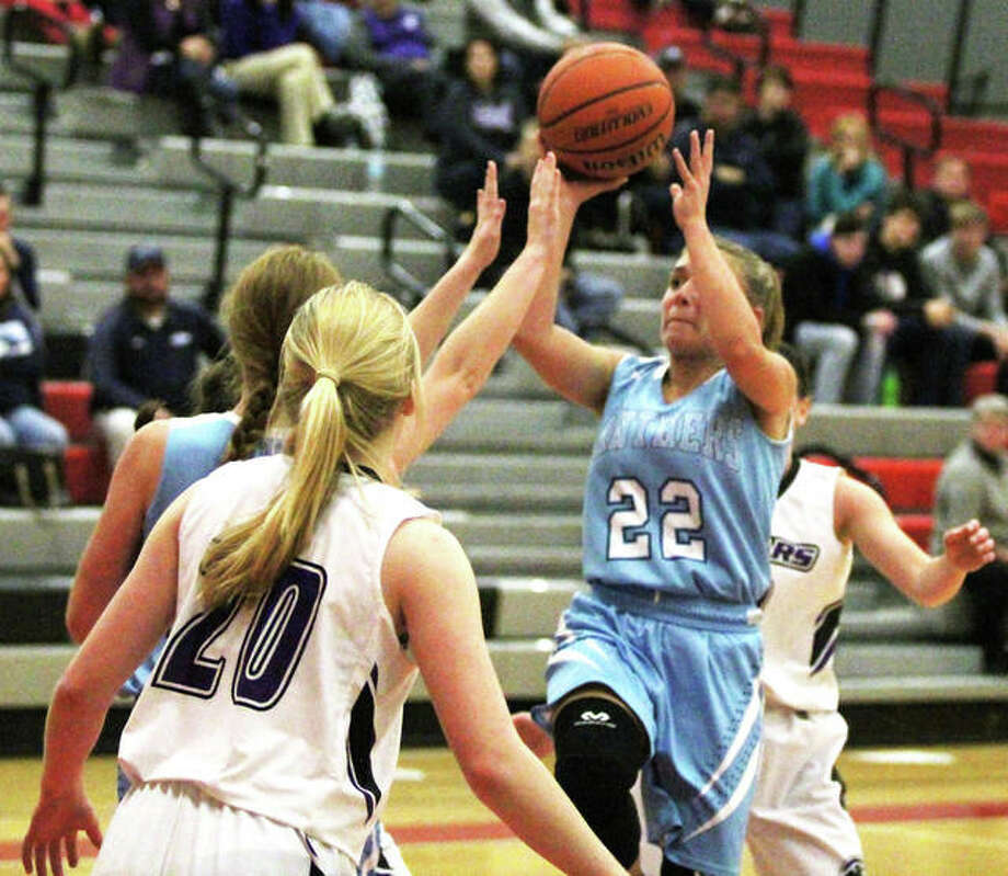 Jersey's Clare Breden (22), shown putting up a shot in the lane in against Breese Central on Tuesday, averaged 24.7 points per game to earn MVP honors Saturday night at the Alton Tip-Off Classic. Photo: Greg Shashack / The Telegraph