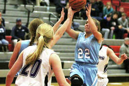 Jersey's Clare Breden (22), shown putting up a shot in the lane in against Breese Central on Tuesday, averaged 24.7 points per game to earn MVP honors Saturday night at the Alton Tip-Off Classic.