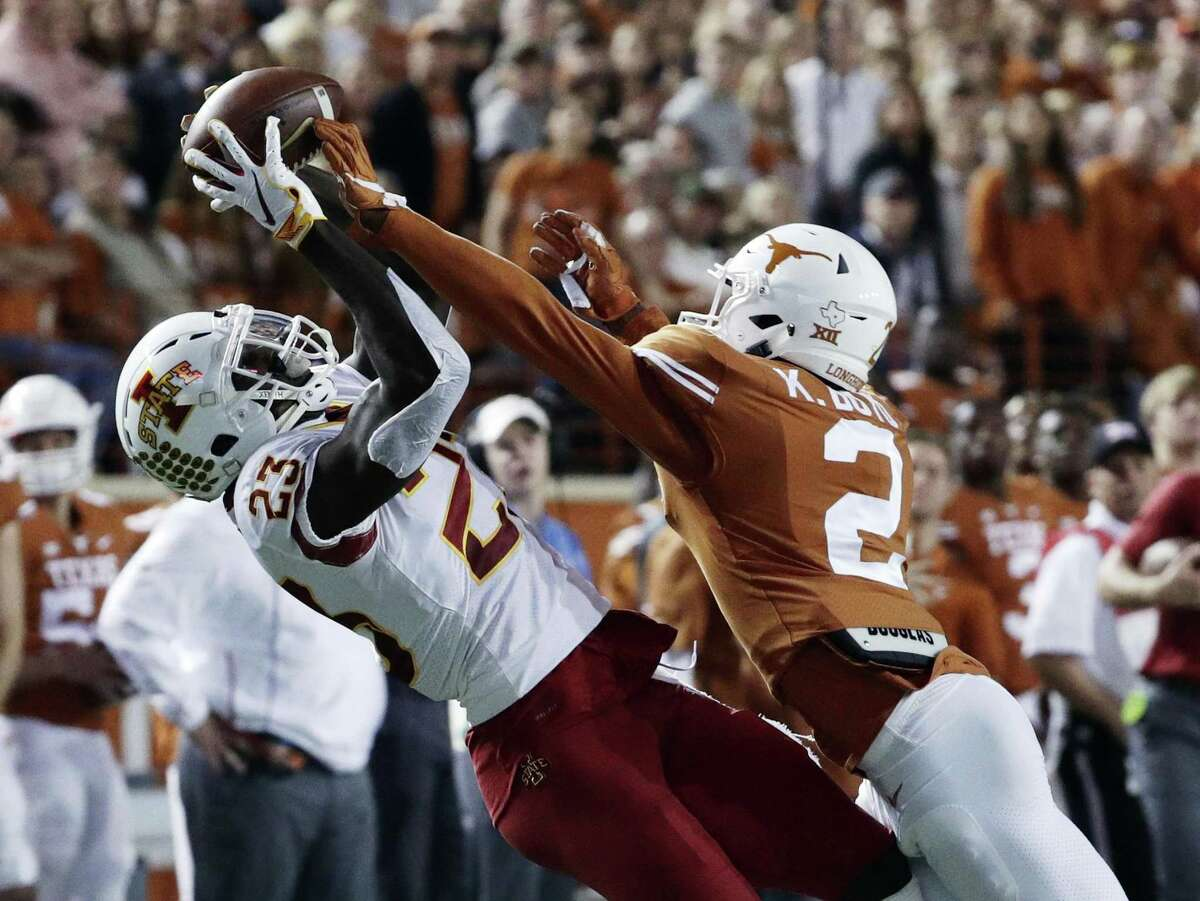 Texas defensive back Kris Boyd, right, breaks up a pass intended for Iowa State wide receiver Matthew Eaton, left, during the first half of the Longhorns' 24-10 win Saturday.